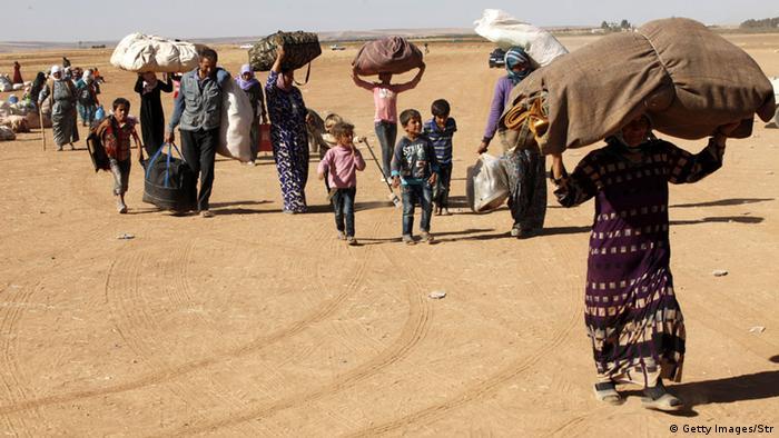 Syrer flüchteten über die Grenze in die Türkei (Foto: Getty Images)