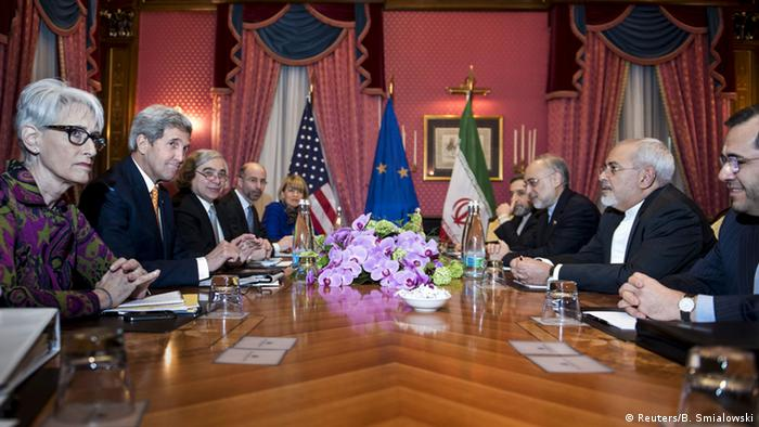 U.S. officials, including Secretary of State John Kerry and Iranian Foreign Minister Mohammad Javad Zarif wait for the start of a meeting in Lausanne on March 26, 2015 during negotiations on the Iranian nuclear program.