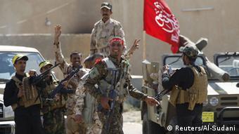 در عملیات چهار هفتهای بازپسگیری تکریت از داعش آمریکا و متحدانش از ارتش عراق حمایت کردند و خواستار کنار گرفتن شیعیان شدند
