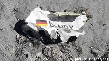 Debris as search and rescue workers are at the crash site of the Germanwings Airbus A320 that crashed in the French Alps, above the town of Seyne-les-Alpes, southeastern France, 26 March 2015. Germanwings Flight 4U 9525, carrying 144 passengers and six crew members from Barcelona, Spain to Dusseldorf, Germany, crashed 24 March in the French Alps, where searchers combed a 4-hectare section of mountain face since 25 March. The co-pilot deliberately crashed the aircraft, French officials said on 26 March. +++(c) dpa - Bildfunk+++