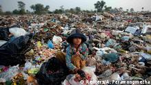 19.03.2015 *** Soburn, an 11-year-old girl, collects what can be used as food for pigs at landfill dumpsite outside Siem Reap March 19, 2015. A second-grade student, she helps her parents in the morning collecting usable items at the dumpsite where they live before going to school in the afternoon. Anlong Pi, an eight-hectare dumpsite situated close to the famous Cambodian resort province of Siem Reap, has recently become a tourist attraction in its own right. Sightseers pose for pictures with children who scavenge scraps for a living, making between $0.25 and $2 per day, according to a representative of a company overseeing the waste. Michelle Obama is due to visit to Cambodia to promote Let Girls Learn, a worldwide initiative that aims to help adolescent girls attend school. REUTERS/Athit Perawongmetha