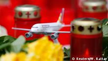 27.03.2015 * A model Germanwings airplane stands amongst candles outside the company's headquarters in Cologne Bonn airport March 27, 2015. Andreas Lubitz, the co-pilot who appears to have deliberately crashed Germanwings flight 4U9525 carrying 149 passengers into the French Alps received psychiatric treatment for a serious depressive episode six years ago, German tabloid Bild reported on Friday. REUTERS/Wolfgang Rattay
