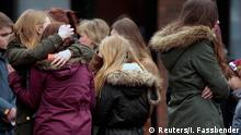 27.03.2015 * Students hug each other after a memorial service at St. Sixtus church in Haltern am See, March, 27, 2015. Some 16 students and two teachers from Josef-Koenig-Gymnasium high school in Haltern am See, were on board the ill-fated Germanwings flight 4U9525 that crashed in a remote snowy area of the French Alps on Tuesday on its way home to Duesseldorf. REUTERS/Ina Fassbender (GERMANY - Tags: TRANSPORT DISASTER TPX IMAGES OF THE DAY)