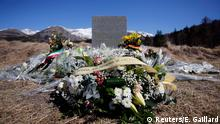 27.03.2015 * A wreath of flowers to the memory of victims from Spain is seen at the memorial for the victims of the air disaster in the village of Le Vernet, near the crash site of the Airbus A320 in French Alps March 27, 2015. A young German co-pilot barricaded himself alone in the cockpit of Germanwings flight 9525 and apparently set it on course to crash into an Alpine mountain, killing all 150 people on board including himself, French prosecutors said on Thursday. The pilot Andreas Lubitz, 27, who appears to have deliberately crashed a plane carrying 149 others into the French Alps received psychiatric treatment for a serious depressive episode six years ago, German tabloid Bild reported on Friday. REUTERS/Eric Gaillard