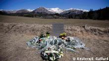 27.03.2015 * Flowers are seen at the memorial for the victims of the air disaster in the village of Le Vernet, near the crash site of the Airbus A320 in French Alps March 27, 2015. A young German co-pilot barricaded himself alone in the cockpit of Germanwings flight 9525 and apparently set it on course to crash into an Alpine mountain, killing all 150 people on board including himself, French prosecutors said on Thursday. The pilot Andreas Lubitz, 27, who appears to have deliberately crashed a plane carrying 149 others into the French Alps received psychiatric treatment for a serious depressive episode six years ago, German tabloid Bild reported on Friday. REUTERS/Eric Gaillard