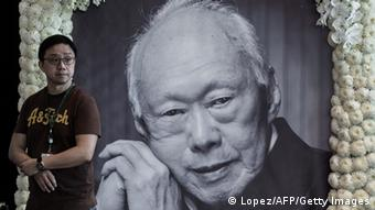A man looks on next to a portrait of late Singapore founding leader Lee Kuan Yew set up ahead of a public broadcast of his funerals in Hong Kong on March 29, 2015 (Photo: PHILIPPE LOPEZ/AFP/Getty Images)