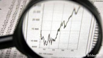 Magnifying glass over stock market chart