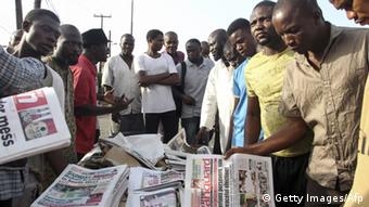 Nigerians at a newspaper stand