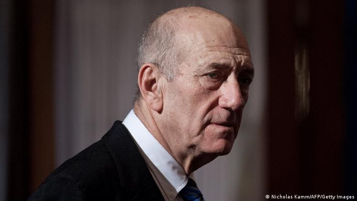 Ehud Olmert in half profile AFP PHOTO/Nicholas KAMM