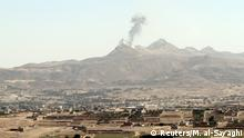 30.03.2015 Smoke billows from military barracks in the Jabal al-Jumaima mountain following an air strike near Sanaa March 30, 2015. Warplanes struck the Yemeni capital of Sanaa overnight and after daybreak on Monday, residents said, the fifth day of a campaign by Saudi-led forces against Houthi forces opposed to President Abd-Rabbu Mansour Hadi. REUTERS/Mohamed al-Sayaghi