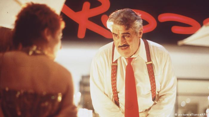Helmut Dietl's Rossini film scene starring Mario Adorf as a restaurant owner (picture-alliance/KPA)