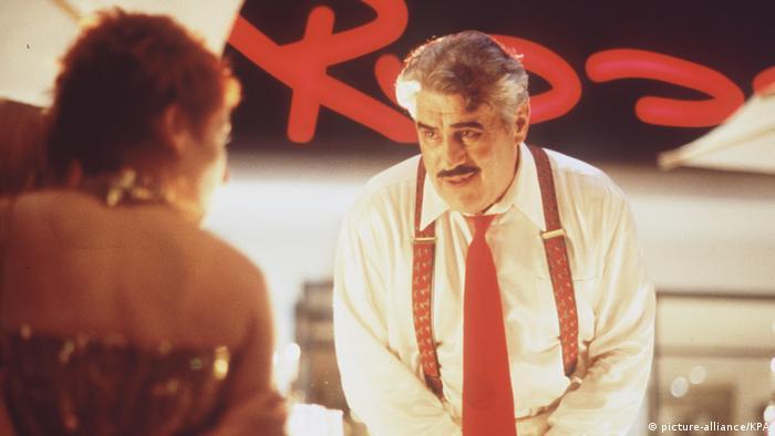 Helmut Dietls Rossini Filmszene mit Mario Adorf als Restaurantbesitzer (picture-alliance/KPA)