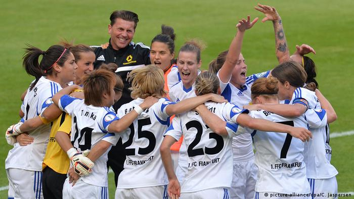 Colin Bell, FFC Frankfurt coach, celebrates with his team after winning the German Cup