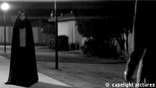 Film - a girl walks home alone at night