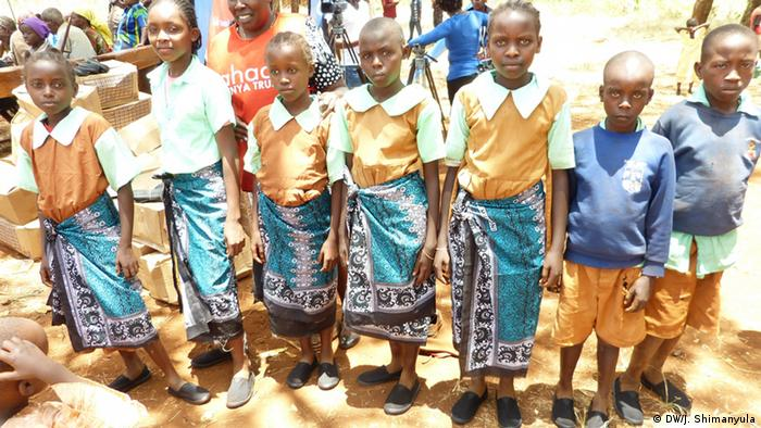 A group of children wearing rubber shoes after being treated for jiggers