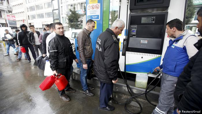 Turks line up at a gas station