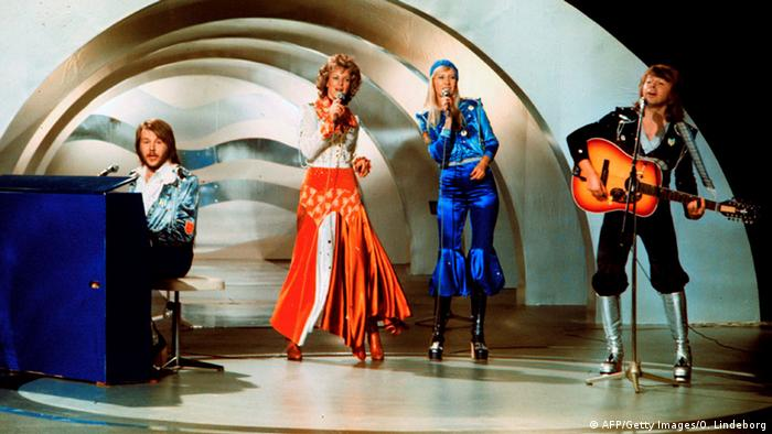 Abba band members in bright costumes perform at the 1974 Eurovison contest in Brighton, England (AFP/Getty Images/O. Lindeborg)