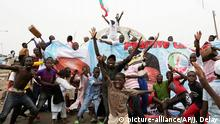 March 31, 2015 Residents celebrate the anticipated victory of Presidential candidate Muhammadu Buhari in Kaduna, Nigeria Tuesday, March 31, 2015. The spokesman for retired Gen. Muhammadu Buhari says the former military dictator has won Nigeria¿s bitterly contested presidential election but fears ¿tricks¿ from the government. Garba Shehu told The Associated Press that their polling agents across the country tell them they have succeeded in defeating President Goodluck Jonathan.(AP Photo/Jerome Delay)