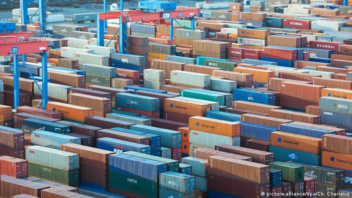 Shipping containers are stacked at the Port of Hamburg