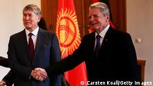 01.04.2015 *** BERLIN, GERMANY - APRIL 01: German President Joachim Gauck (R), his partner Daniela Schadt (L) welcome Kyrgyzstan President Almazbek Atambayev upon his arrival at Schloss Bellevue palace on April 1, 2015 in Berlin, Germany. Atambayev is on an official visit to Germany and is meeting with both President Gauck and Chancellor Merkel. (Photo by Carsten Koall/Getty Images)