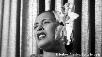 Billie Holiday, with a white orchid in her hair