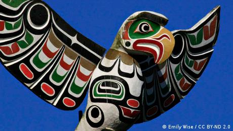 Photo: An eagle no a totem pole (Photo Source: cc/by/Emily Wise)