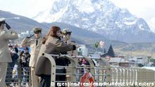 Argentina's President Cristina Fernandez de Kirchner throws flowers into the waters of Bahia de Ushuaia (Ushuaia Bay) to pay homage to the fallen soldiers during the Falklands War in Ushuaia April 2, 2015. Britain should spend more helping its own poor than on defending the Falkland Islands, Fernandez said on Thursday, responding to a recently-announced budget increase aimed at protecting the contested archipelago. Britain's government said last week it would reinforce its military presence on the Falklands to counter the very live threat posed by Argentina. Fernandez, in a speech honouring soldiers who died in her country's failed 1982 invasion of the South Atlantic islands, dismissed the idea of Argentina being a threat, telling Britain to focus instead on fighting poverty within its own borders. REUTERS/Argentine Presidency/Handout via Reuters ATTENTION EDITORS - THIS PICTURE WAS PROVIDED BY A THIRD PARTY. REUTERS IS UNABLE TO INDEPENDENTLY VERIFY THE AUTHENTICITY, CONTENT, LOCATION OR DATE OF THIS IMAGE. THIS PICTURE IS DISTRIBUTED EXACTLY AS RECEIVED BY REUTERS, AS A SERVICE TO CLIENTS. FOR EDITORIAL USE ONLY. NOT FOR SALE FOR MARKETING OR ADVERTISING CAMPAIGNS