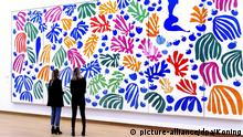 epa04678675 Visitors look at 'La perruche et la sirene' of French artist Henry Matisse at the preview of the exhibition 'De Oase van Matisse' in the Stedelijk Museum, Amsterdam, the Netherlands, 25 March 2015. The exhibit runs from 27 March to 16 August. EPA/SANDER KONING