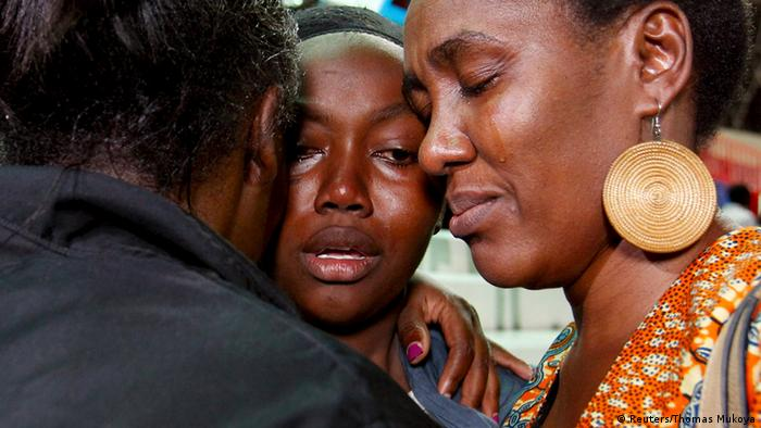 People react after meeting their relative (C) who was rescued from the Garissa University attack at Nyayo stadium in Kenya's capital Nairobi April 4, 2015. REUTERS/Thomas Mukoya