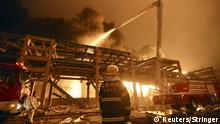 A firefighter looks on as he and his colleagues try to extinguish a fire at a petrochemical plant in Zhangzhou, Fujian province April 7, 2015. At least six people were injured after an explosion hit part of an oil storage facility on Monday at Dragon Aromatics, an independent petrochemical producer in eastern China, Xinhua reported. The blast happened around 7 p.m. (1100 GMT) at a pumping station for a condensate storage at the plant in Zhangzhou in Fujian province that produces paraxylene, or PX, a chemical used in making polyester fibre and plastics, state media said. REUTERS/Stringer ATTENTION EDITORS - CHINA OUT. NO COMMERCIAL OR EDITORIAL SALES IN CHINA