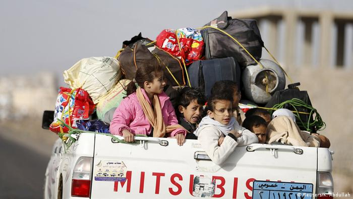 Children look out from the tray of a pick-up truck in Yemen. (Photo: Khaled Abdullah)