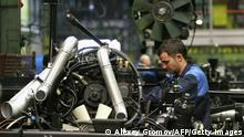 A workman assembles the engine of a MAZ heavyweight truck at a plant in Minsk on August 27, 2009. Belarus' state-owned automaker MAZ will turn 65 this year. AFP PHOTO / ALEXEY GROMOV (Photo credit should read ALEXEY GROMOV/AFP/Getty Images)