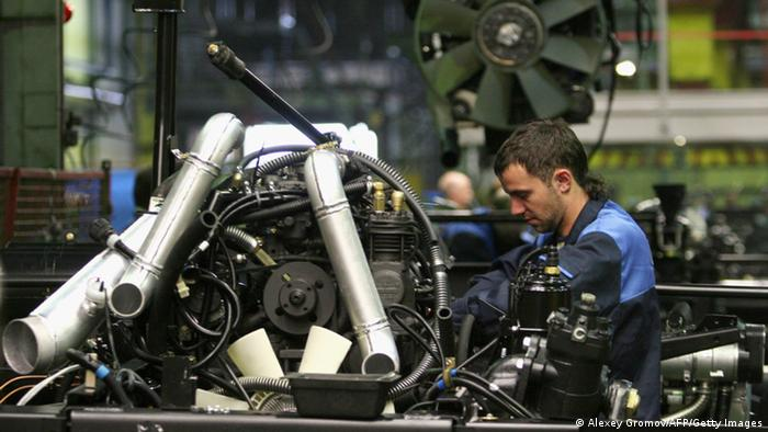 A worker at Belarus state-owned carmaker MAZ