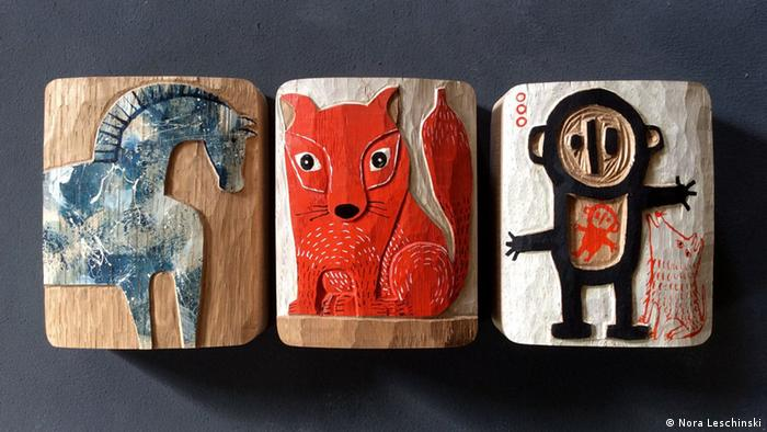 Three wooden reliefs of animals and human figures, Copyright: Nora Leschinski