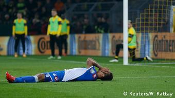 Hoffenheim player lies on the ground after losing to BVB