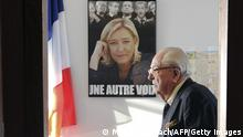 12. Jan 2014 Front national honorary president Jean-Marie Le Pen is pictured next to a campaign poster of his daughter, the president of the party Marine Le Pen, on January 12, 2014 in Agen, prior to give a press conference after sharing an epiphany cake with militants as part of a support visit to local candidates for the upcoming mayoral elections. AFP MEHDI FEDOUACH (Photo credit should read MEHDI FEDOUACH/AFP/Getty Images)