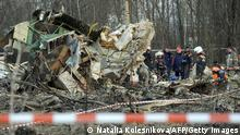 (FILES) In a photo taken on April 11, 2010, Russian rescuers inspect the wreckage of a Polish government Tupolev Tu-154 aircraft which crashed on April 10 near Smolensk airport, that killed president Lech Kaczynski and dozens of other high-profile Poles. Polish Prime Minister Donald Tusk said on August 4, 2011, that three Polish air force generals and 10 other top officers have been fired after a probe into last year's plane crash. AFP PHOTO / NATALIA KOLESNIKOVA (Photo credit should read NATALIA KOLESNIKOVA/AFP/Getty Images)