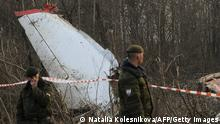 Soldiers of the Russian Interior Ministry stand guard on April 11, 2010 near the wreckage of a Polish government Tupolev Tu-154 aircraft which crashed on April 10 near Smolensk airport. Appalling as it is, the plane tragedy that killed Poland's president is a potential game-changer in thorny Russian-Polish ties that may impact broader East-West relations in Europe, experts say. AFP PHOTO / NATALIA KOLESNIKOVA (Photo credit should read NATALIA KOLESNIKOVA/AFP/Getty Images)