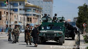 Afghan security personnel arrive at the site where an attack by gunmen is taking place at a court complex in Mazar-i-sharif on April 9, 2015. USYAN FARSHAD USYAN/AFP/Getty Images
