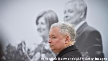 Jaroslaw Kaczynski, the twin brother of the late President, stands during a wreath laying ceremony in front of the presidential palace in Warsaw April 10, 2011, to commemorate the first anniversary of a plane crash in Smolensk that killed 96 people. Russia stoked Sunday the flames of a new diplomatic flare-up with Poland by expressing bewilderment at Polish anger over its decision to replace a plaque marking the death of the country's president.The original version of the commemorative sign noted that Lech Kaczynski and 95 other crash victims had been travelling to the Russian town of Katyn to mark the 70th anniversary of the murder of 22,000 Polish officers by Soviet secret police. AFP PHOTO WOJTEK RADWANSKI (Photo credit should read WOJTEK RADWANSKI/AFP/Getty Images)