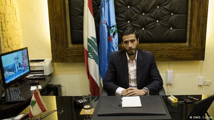 Ali Fouda sits at a desk