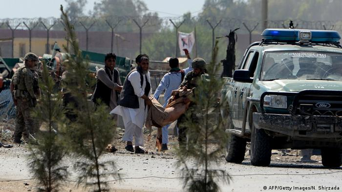 Afghan residents move a wounded person after a suicide car bomb targeted a NATO convoy in Jalalabad city on April 10, 2015. AFP PHOTO / Noorullah Shirzada Noorullah Shirzada/AFP/Getty Images