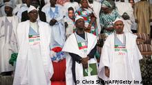 14.02.2015 *** Nigerian presidential candidate of the main opposition All Progressives Congress (APC), Muhammadu Buhari (L) and vice-presidential candidate Yemi Osinbajo (C) attend a campaign rally on January 19, 2015 in Kaduna. Buhari will face President Goodluck Jonathan on February 14, 2015 as the APC seeks to unseat the Peoples Democratic Party (PDP) for the first time since 1999. AFP PHOTO / CHRIS STEIN (Photo credit should read Chris Stein/AFP/Getty Images)