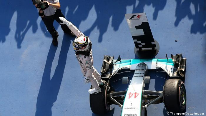 Lewis Hamilton raising arm to crowd after Grand Prix victory Photo by Mark Thompson/Getty Images