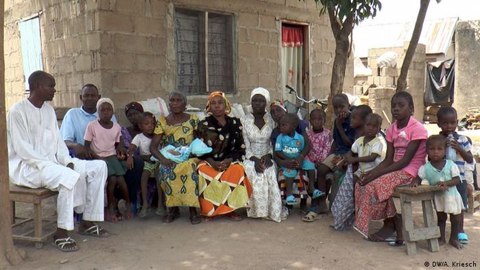A family of one of the missing Chibok girls with neighbors