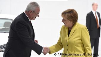 Angela Merkel greets Volkswagen boss Martin Winterkorn