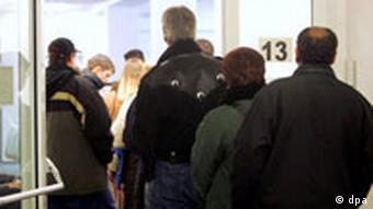 People stand in line at an unemployment office