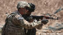 12.04.2015 * Bildunterschrift:TAJI, IRAQ - APRIL 12: A U.S. Army trainer (L), instructs an Iraqi Army recruit at a military base on April 12, 2015 in Taji, Iraq. U.S. forces, currently operating in 5 large bases throught the country, are training thousands of Iraqi Army combat troops, trying to rebuild a force they had origninally trained before the U.S. withdrawal from Iraq in 2010. Members of the U.S. Army's 5-17 CAV Squadron are teaching members of the newly-formed 15th Division of the Iraqi Army, as the Iraqi government launches offensives to try to recover territory lost to ISIS last year. (Photo by John Moore/Getty Images)