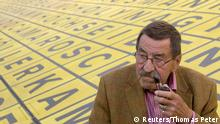 September 8, 2009 Nobel laureate, German author Guenter Grass smokes a pipe before a TV interview after a campaign event for the Social Democratic Party (SPD) in front of the Berlinische Galerie in Berlin, in this September 8, 2009 file picture. German novelist Guenter Grass, the Nobel Prize-winning author of works such as The Tin Drum, has died at the age of 87, a foundation in his name said on Monday. REUTERS/Thomas Peter/Files