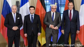 Deutschland - (L-R) French Foreign Minister Laurent Fabius, Ukrainian Foreign Minister Pavlo Klimkin, German Foreign Minister Frank-Walter Steinmeier and Russian Foreign Minister Sergei Lavrov AFP PHOTO / POOL / CLEMENS BILAN/AFP/Getty Images